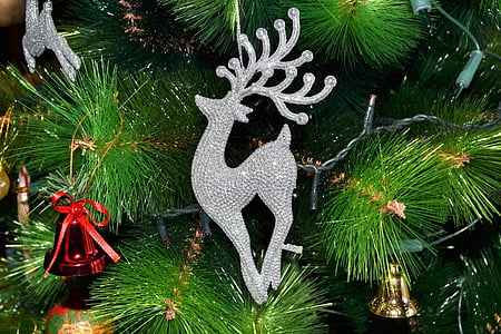 closeup of Christmas tree with bells and deer ornaments