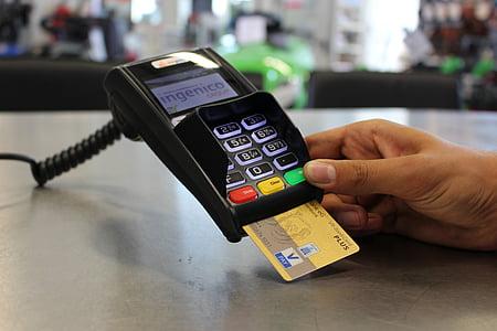 Ingenico credit card terminal with VISA card
