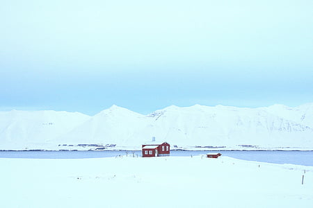 red house surrounded by snow