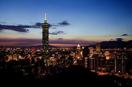 city skyline during twilight