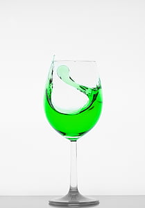 clear wine glass filled with green liquid