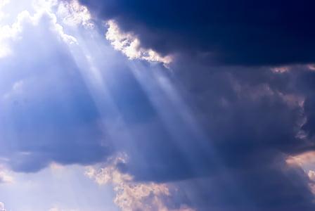 sunbeam on white clouds