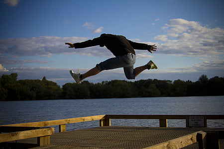 man in black hoodie jumping