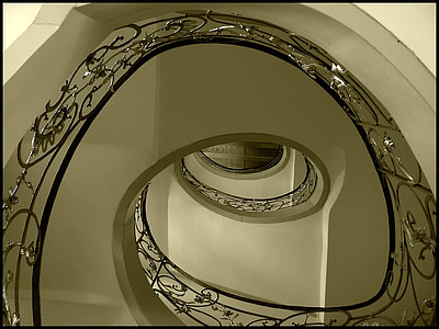 high-angle photography of spiral staircase with railings