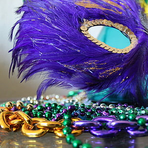 photo of purple and gold masquerade mask