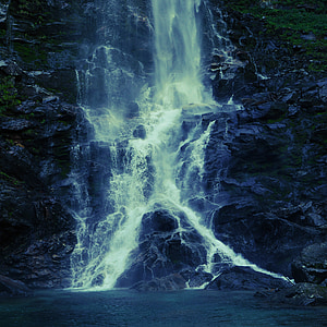 photo of waterfalls during nighttime