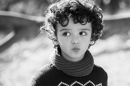 child wearing turtleneck sweater looking right