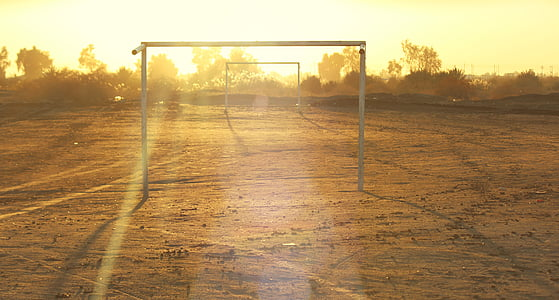 white metal goal net frames outdoors