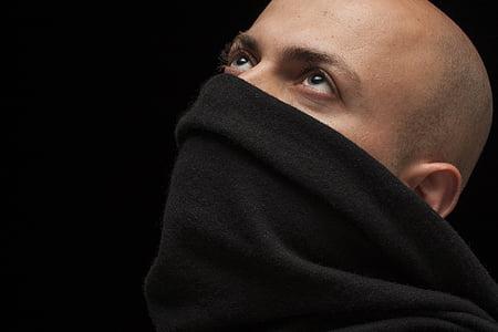 man wearing black neck warmer
