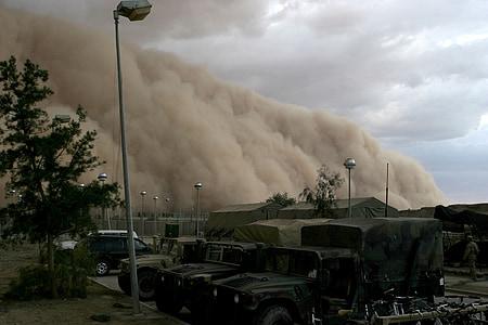 large brown smoke on military camp during dayime