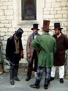 four men wearing coats