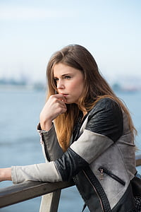 woman in gray and black leather full-zip jacket