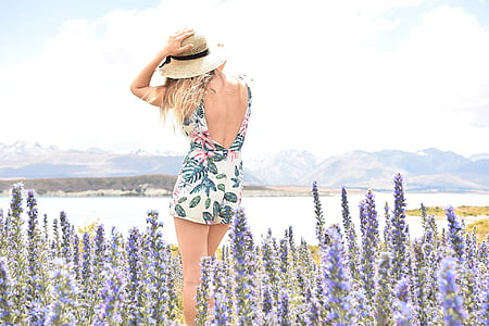 woman wearing floral backless dress surrounded by lavender flowers