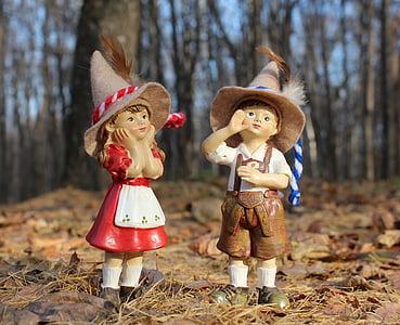 boy and girl ceramic figurines