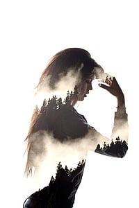 edited photo of woman and pine trees