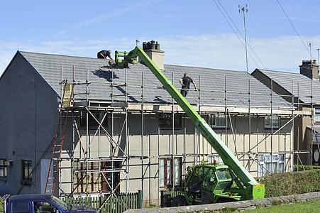 cherry picker working on roof