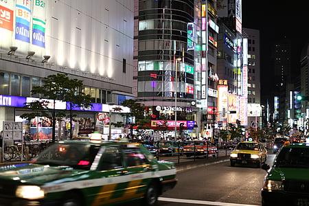 people walking near building at nighttime