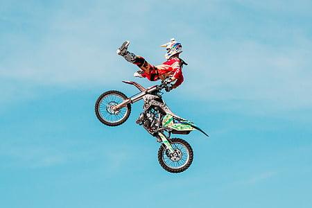 man doing air stunt on motocross dirt bike