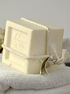 white cube soap on white towel