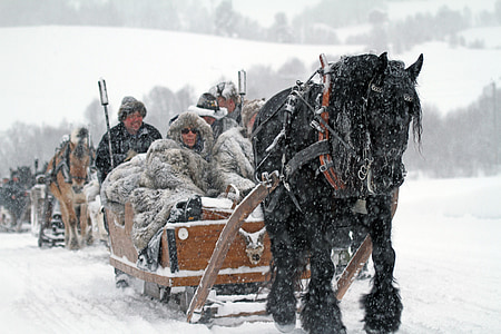person riding on sled surrounded by snow