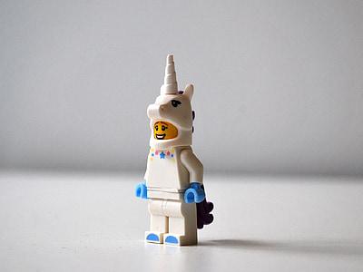 white and blue unicorn Lego mini figure