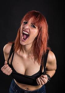 woman holding her black scoop-neck crop top