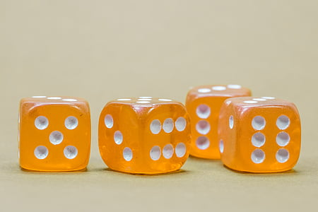 four orange-and-white dices