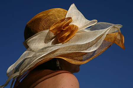 woman wearing white and brown sun hat
