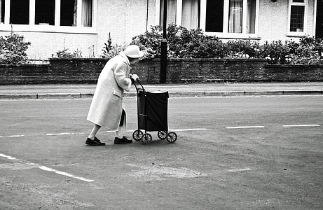 woman holding cart on road