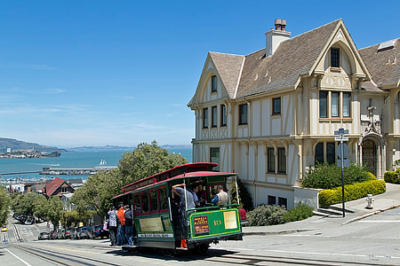 photo of people riding on tram