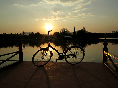 black cruiser bike on dock during golden hour