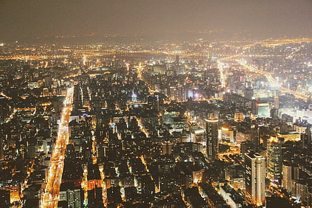 aerial photo of lighted high-rise buildings