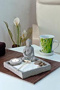 Buddha figurine on table