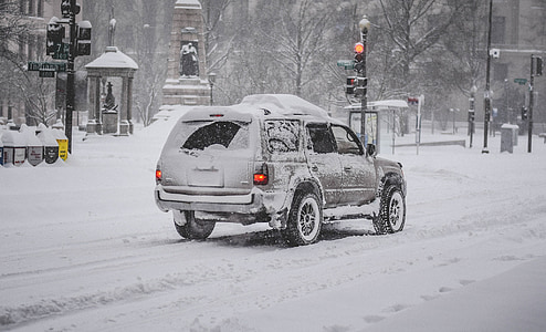 grey SUV with snow cap