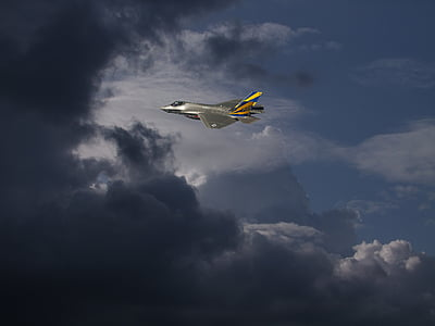 gray fighter jet above clu