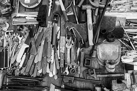 grayscale photo of assorted tools