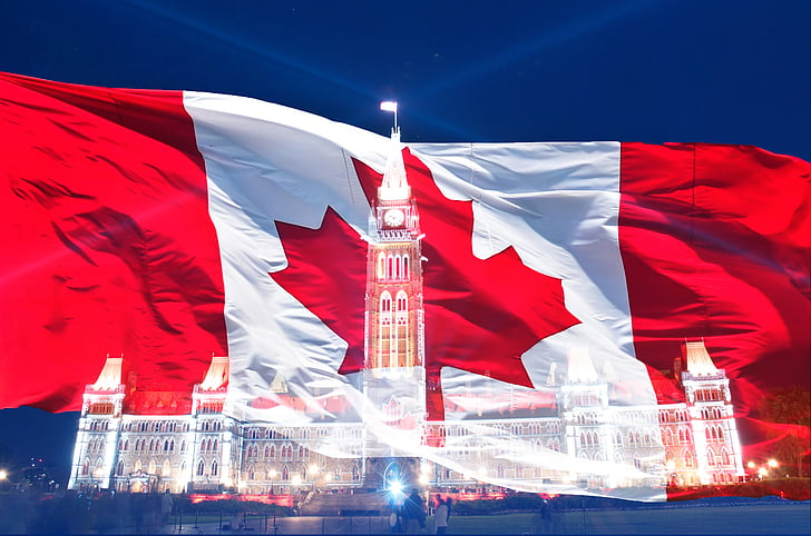 flag of Canada and lighted mansion