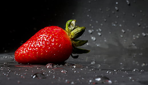 strawberry on wet surface