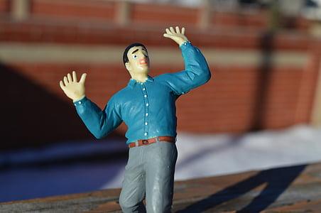 man figurine during daytime