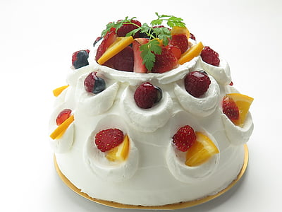 white icing cake with strawberry and citrus fruits