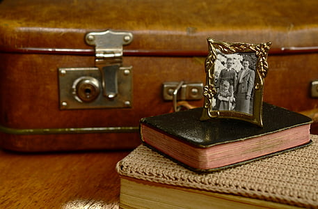 brass photo frame with book