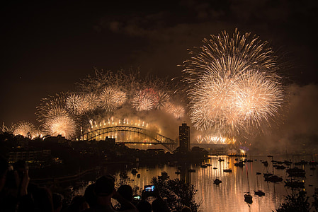 people watching bridge with fireworks