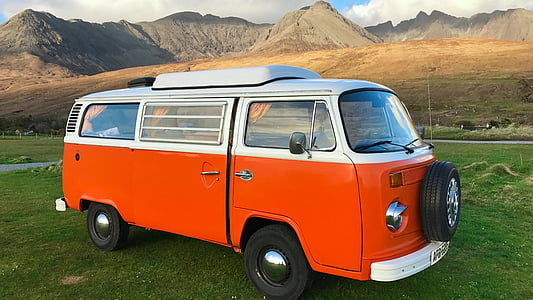 orange and white Volkswagen T1 van parked during daytime