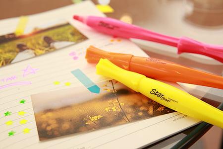 three yellow, pink, and orange pens