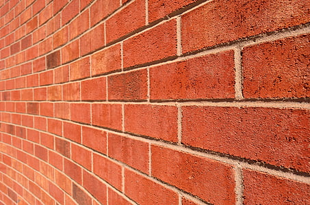 red brick wall during daytime photography