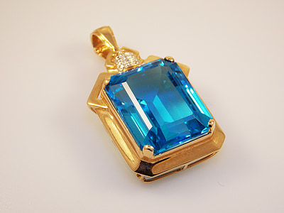 gold-colored blue gemstone stud pendant