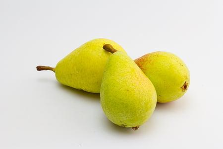 three yellow citrus fruits