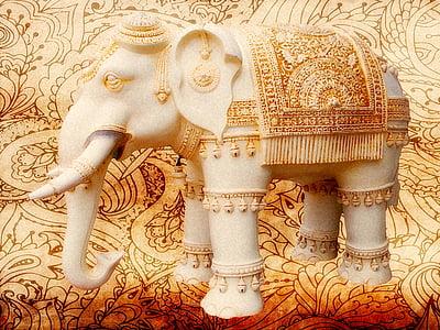 beige concrete elephant statue