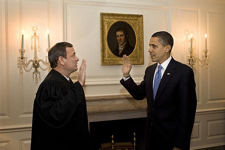 Barack Obama in front of man