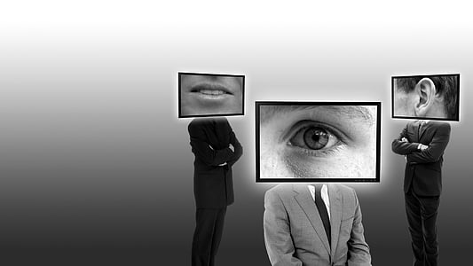 grayscale photo of three person with parts of face screen